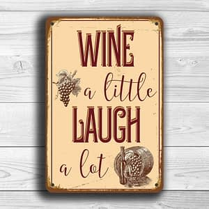 Wine a little laugh a lot sign
