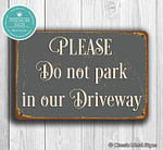 Please do not park in Our Driveway Sign